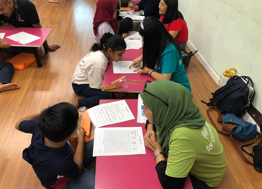 Malaysian children being taught by teachers