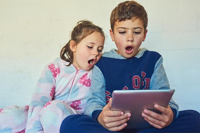 Shocked children looking at ipad